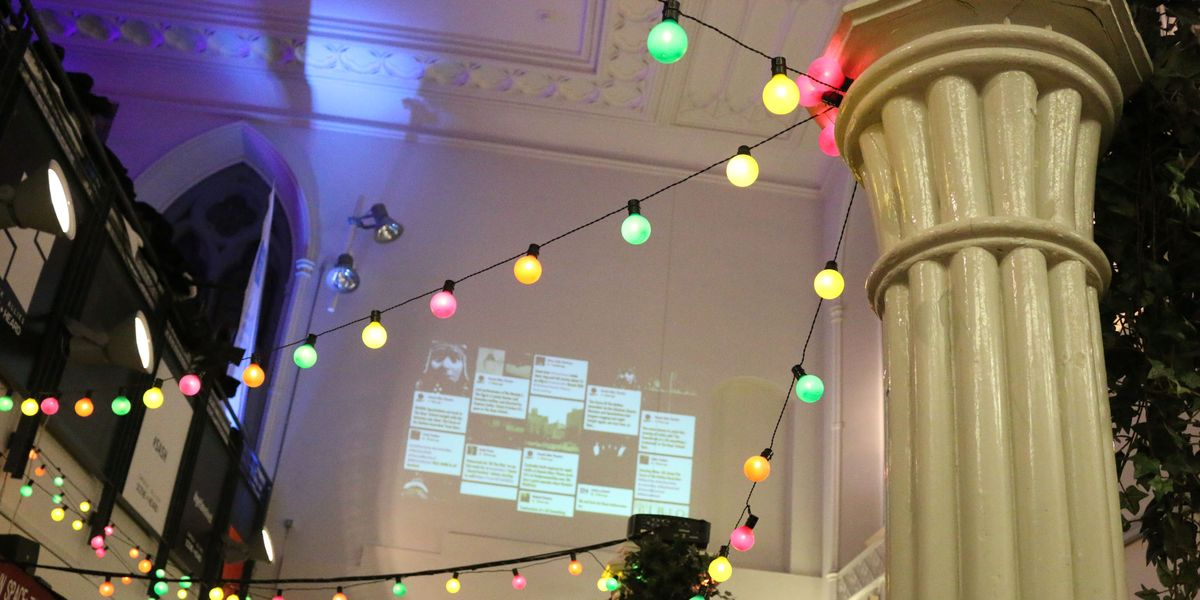 festoon lights, projection of a twitter feed on the wall
